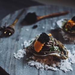 An appetizer upgrade that is elegantly luxe looking, but pretty darn simple to pull off. Oyster on the half shell topped with wine-butter infused black soba noodles, uni and caviar.