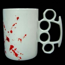 """The knuckle duster mug by Thabto LTD.  Their website states that the handle will """"ensure nobody steals your biscuits."""" I want."""