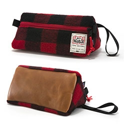 Topo Designs x Woolrich Dopp Kit. The Topo Dopp we love, with a cozy Woolrich twist. 100% Woolrich wool outer, leather base, coated pack cloth liner.