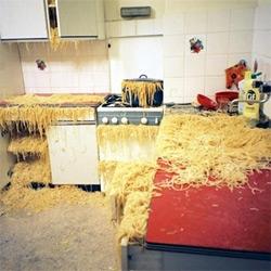 Remember Strega Nona's Magical Pasta Pot, and when Big Anthony has pasta everywhere? Here's the installation: Heute bleibt die Küche kalt, wir gehen in den Wienerwald by Marlene Haring, 2004...
