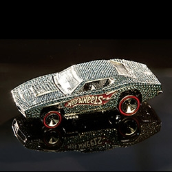 Hot Wheels is commemorating 4 billion cars having rolled from their assembly line, and they're doing it in style with a teeny car, encrusted with diamonds.