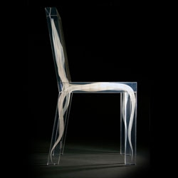 Strange clear acrylic chair by Ralph Nauta and Lonneke Gordijn of design drift - with what looks like white liquid injected during moulding.
