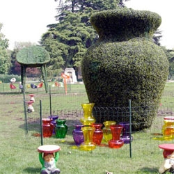 Milan 08 - Kartell's gigantic topiary of designer seating... surrounded by tiny real versions... in the gardens at the Trienalle - absolutely brilliant!!!