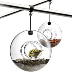 The ball-shaped Eva Solo bird feeder is a decorative feature outdoors and a popular feeding place for the small birds in the garden all year round.