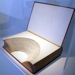 'buch mit amphitheatralischer einrichtung' (book with amphitheatrical furnishings) - 2001 work by the german artist hubertus gojowczyk. Designboom has great coverage of Art Basel 2008