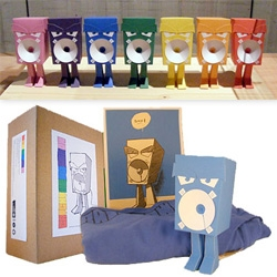 sjors trimbach (aka brickboy) ~ 14 papermodels (dubbed SPEAKERBOSS) in the colors of the rainbow, Matt Joyce printed (and sponsored) t-shirts in the same colors, and  a mini-print ~ all boxed ~ and proceeds go to the Dutch Cancer Society.