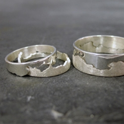 Hanna Louise Lamb rings ~ Hand pierced silver coast rings based on a coastline map. Any map done to commission. ~ i'd love to have some made of home! (Also in gold and with diamonds... fun wedding bands?)