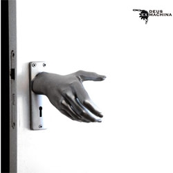 You shake to open? This is one creepy door Hand-le by Naomi Thellier de Poncheville
