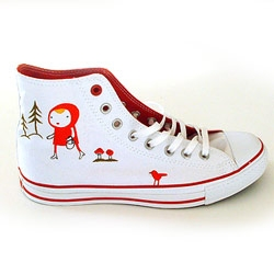 Camilla Engman was invited to decorate a pair of  (RED) Converse Shoes.