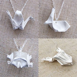 I used to love making tiny origami - it kind of blows my mind that over at finger magic they are actually folding these out of mini sheets of silver!