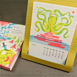 The 2012 Studio on Fire desk calendar! This year the theme is the Positive Apocalypse, featuring include brain-feasting zombies, a yeti, transfigured animals, Earth being devoured and a rainbow explosion.