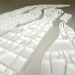 Matthew Picton creates sculptural maps of cities using books about them.