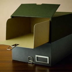 Beautiful Monocle archive boxes that even have a secret compartment for your passport and valuables.