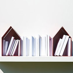 Domus bookends. Love the idea of creating a house for your books to hold up your books.