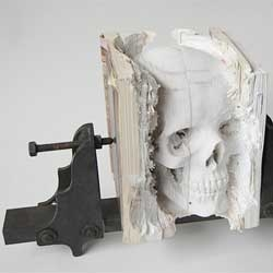 'Incarnate (Three Degrees of Certainty II)' an incredibly realistic human skull carved from old computer manuals by Maskull Lasserre.