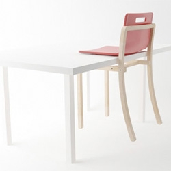 Hold Chair. up and out of the way as seat and back slide up the backrest frame. The chair can then be slid onto the table and cantilevered by its plastic seat. By Poh Liang Hock.