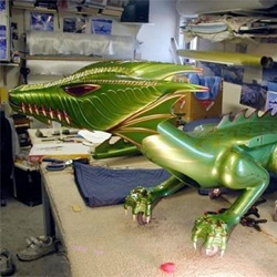 A 7' remote controlled dragon that breathes fire and flies created by Rick Hamel.