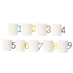 Colorful number mugs at the Spoon Sisters shop.