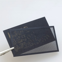 Moiré Card by Karl D. D. Willis,  an obfuscated business card that consists of two layers of laser cut material: an encoded design layer and a decoding mask layer.