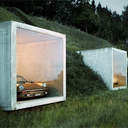 Gorgeous garage (Garagenatelier) in Herden, Switzerland embedded into the landscape by Peter Kunz Architektur.