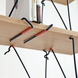 Holdfast, a furniture range from Sam Weller uses the holdfast clamping system typically used for holding material to the surface of a workbench.