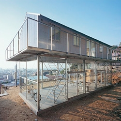 The beautiful House in Rokko by Tato Architects is a barn perched atop glass box on a hillside overlooking Kobe.