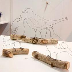 Wire Wonderland from Hayley Dix spotted at New Designers 2012. Beautiful wire sculptures perched on real branches.