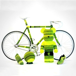 A Flyknit BE@RBRICK, Lunarlon skateboard and a Flyknit covered fixed wheel bicycle all sporting the striking Volt colorway part of the Nike Japan Innovation Hunt.