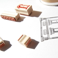 Paper Neighborhood, a set of 21 vulcanized rubber stamps, depicting a single characteristic of Italianate-style architecture (common in the late 19th century).