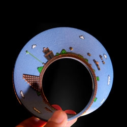 Level 1 of Super Mario Bros, 3D printed as a mobius strip. Poor Mario, starting and ending at the same place every time.