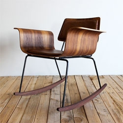 Modern and vintage combine with this molded plywood rocker 'Roxy' chair.