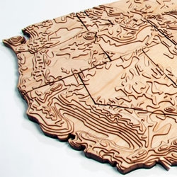 54/50 make geographically inspired pieces like this laser-cut wooden topographical map of the United States.