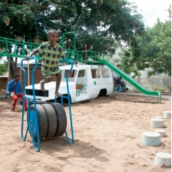 Pim van Baarsen and Luc van Hoeckel's playground for disabled Children in Malawi made from recycled materials in cooperation with Sakaramenta, its components include an old ambulance.