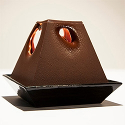 Lumière au Chocolat by Alexander Lervik -The Poetry of Light Chocolate Lamp. Heat from the lamp causes the chocolate to begin melting. Holes soon form, and as the light grows, the chocolate melts.