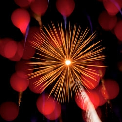 Nick Pacione's Explosions in the Sky captures fireworks with a macro lens and rack focus technique.