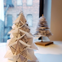 This elegant origami Christmas tree is made by folding up eight pieces of paper. Make your own by recycling paper from work!