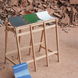 Stools and benches with seats made from roofing tiles from Tsuyoshi Hayashi.