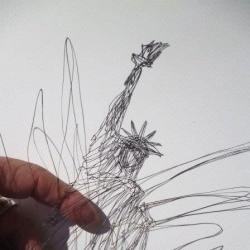 Intricate paper cuts by Akira Nagaya.