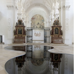 La Mise en Abîme by Romain Crelier consisting of two pools of used motor oil that reflect the structure of Switzerland's Bellelay Abbey.