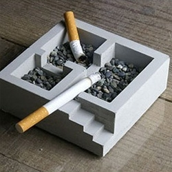 "This cute ""KISO"" ashtray is made completely from concrete, It is divided into 3 rooms, giving heavy smokers more choices of space to smoke (even by the stairs!). Individually hand made in japan by Nobuhiro Sato."
