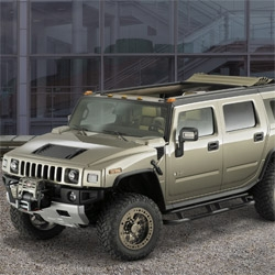 Hummer H2 Safari ~ like a trainwreck, i can't help looking.... but that retractable roof is an interesting design