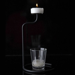 More from 100% Tokyo ~ RICE Design ~ this candle recycles itself into new candles... feels a bit like the table top version of the chandeliers we showed earlier