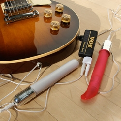Vox AmPlug + OhMiBod = Vibrator(s) controlled by Guitar. (Could also work wonders for the girlfs of gamer boys)