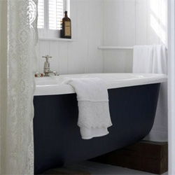 Design*Sponge highlights this incredible bathroom. I now need a matte black classic bathtub with that shiny white spilling out of it someday... only mine would have crazy claws/feet not wood blocks.