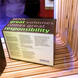 Nokia goes green at CES ~ with the 3110 Evolve, a fun booth display with great use of wood, some nice 60% recycled packaging, and a very fun vinyl stickered hybrid!