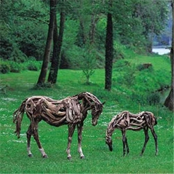 Life-sized horses built out of scrap driftwood by Heather Jansch.