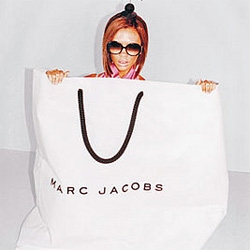 On bizarre upcoming ad campaigns... victoria beckham... for marc jacobs... in the ultimate packaging campaign? she comes out of bags and boxes?