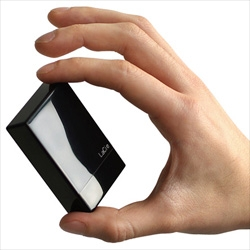 Just a tiny bit larger than a zippo ~ here's the latest in glossy tech from La Cie ~ the Tiny Disk which holds 30/40 GB and even has a cap/built in USB! See the close ups!