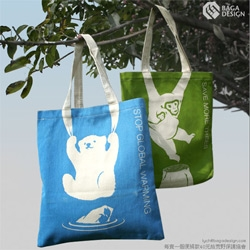 "Baga Design's ""Stop global warming: save the polar bear"" bag has an adorable design that manages to incorporate the handles into it quite playfully."
