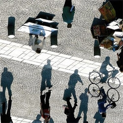 Awesome perspective shift in this photograph of shadows walking the earth...